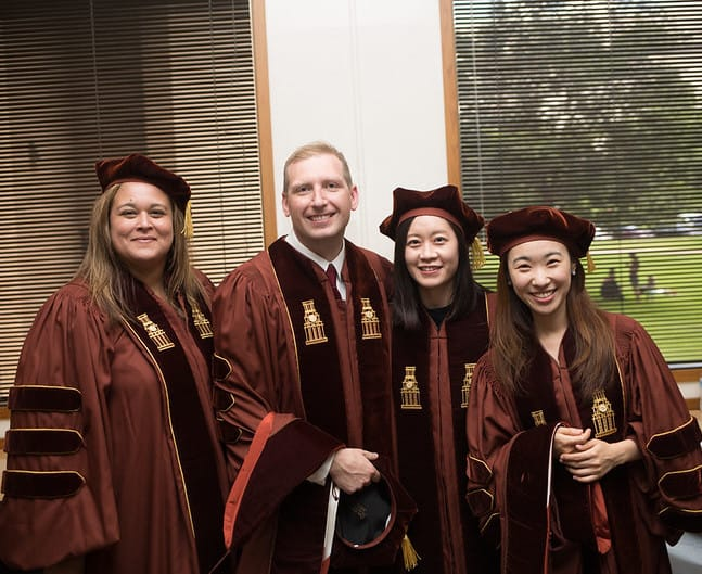 doctoral students at graduation
